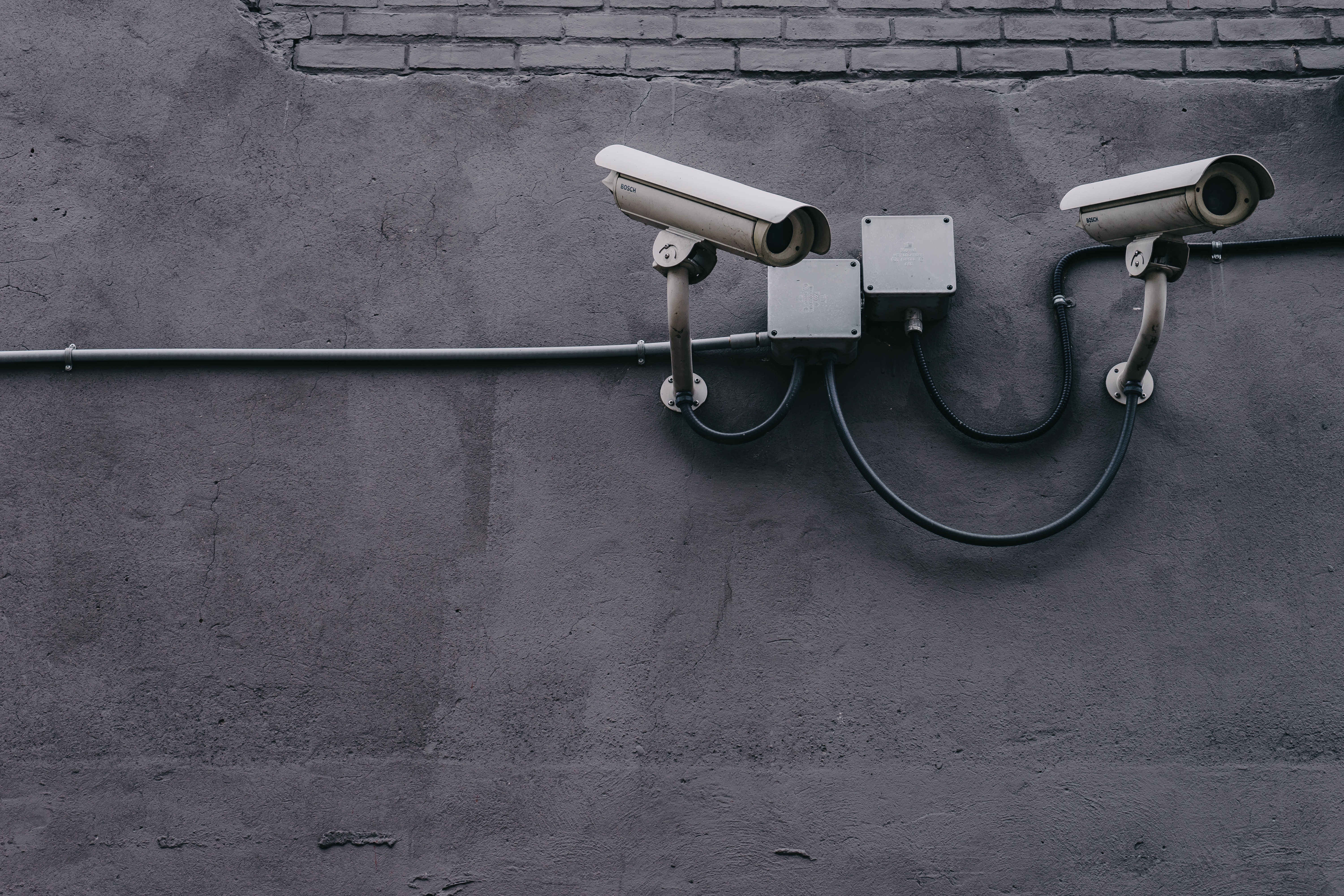 Two security cameras on a wall